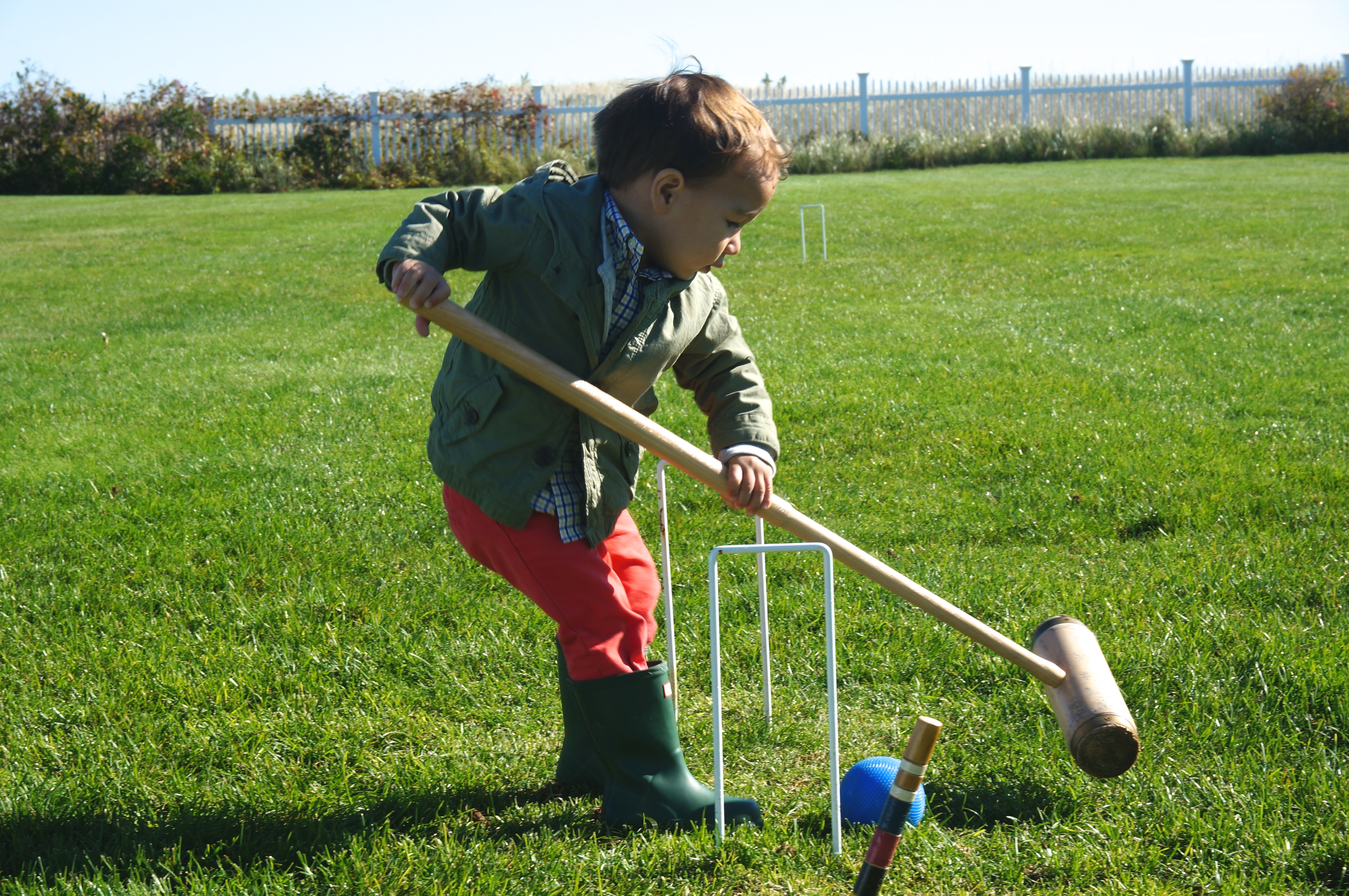 toddler playing croquet