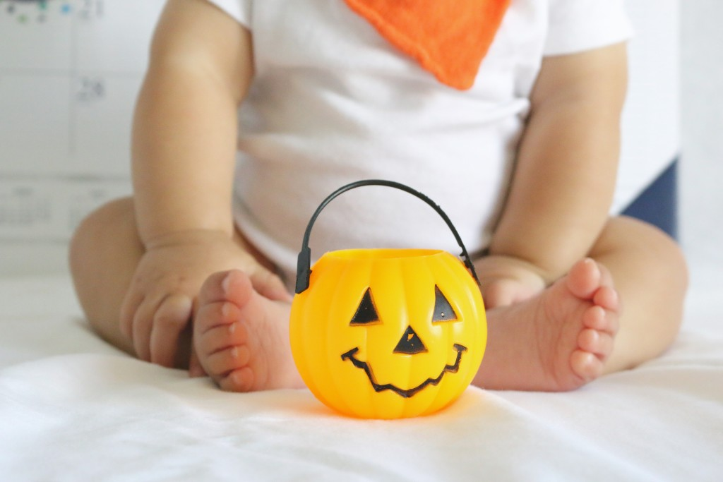 baby with pumpkin